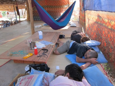 my friends napping at Om beach, Gokarna