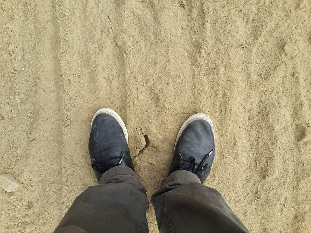 Standing on a sandy road on the way to Bairabi
