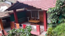 Our private balcony. Ganesh Estate Homestay, Madikeri