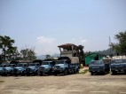 BSF trucks line in front of the old Air Traffic Control Tower at Tuirial Airfield, Mizoram.